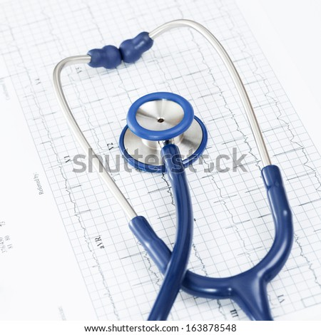 Studio shot of stethoscope over ecg graph - stock photo
