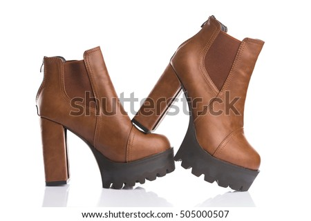 Studio shot of stylish brown autumn boots, isolated on white background