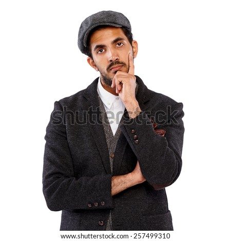 Studio shot of thoughtful young indian man with his hands on chin  on white background  - stock photo
