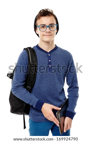 Studio shot of trendy teenager with backpack, wearing cap and glasses and holding a tablet, isolated over white background - stock photo