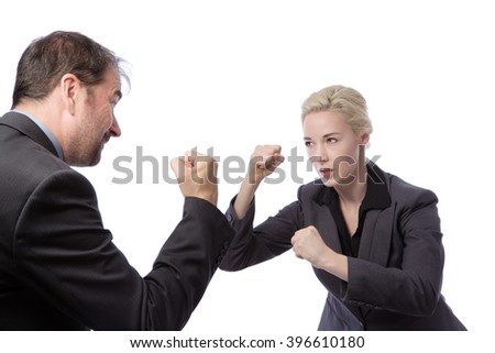 Studio shot of two co-workers wearing suits, fighting in the office, isolated on a white background. - stock photo
