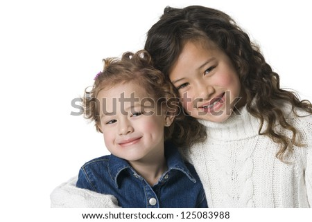 Studio shot of two sisters posing and smiling