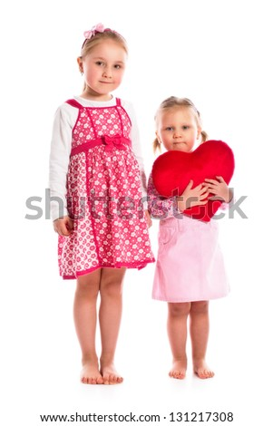 studio shot of two sisters with heart