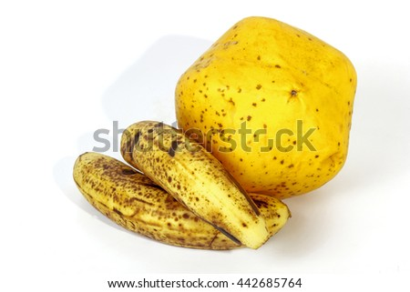 Studio shot of two speckled bananas alongside ripe yellow paw paw on white