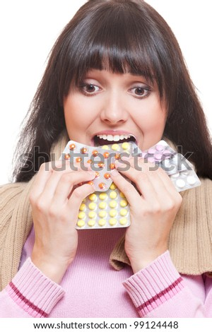 studio shot of woman eating pills. over white background