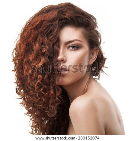 studio shot of woman with healthy brown curly hair isolated over white background
