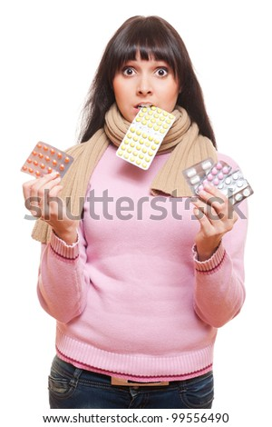 studio shot of woman with pills. isolated on white background