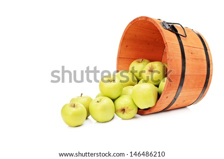 Studio shot of yellow apples in a wooden bucket isolated on white background - stock photo