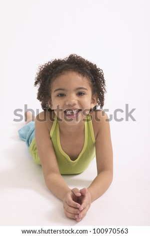 Studio shot of young African girl smiling