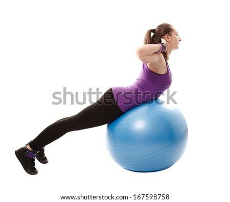 Studio shot of young athletic woman working her back muscles on the ball, isolated over white background