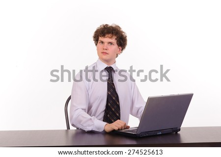 Studio shot of young business man with laptop