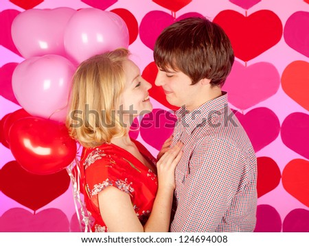 studio shot of young couple in love, over colorful background