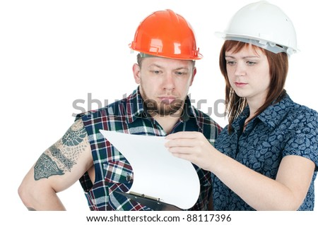 Studio shot of young female architect and building contractor discussing documents, over a white background - stock photo
