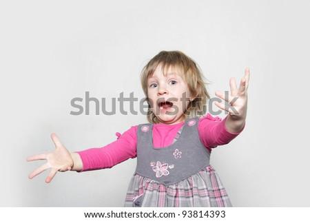 studio shot of young girl shouting - stock photo