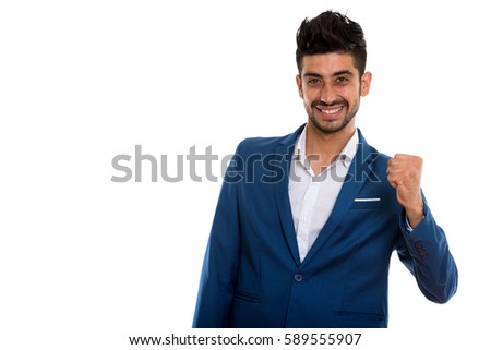 Studio shot of young happy Persian businessman smiling while looking motivated