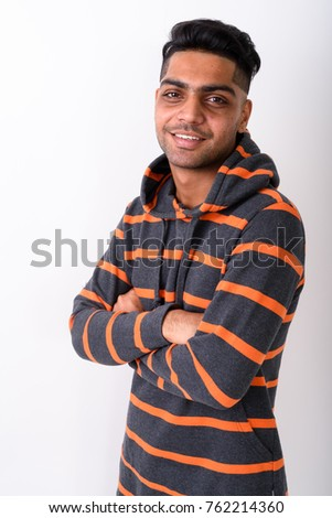 Studio shot of young Indian man wearing hoodie against white background