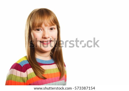 Studio shot of young little 9-10 year old girl, wearing colorful pullover,