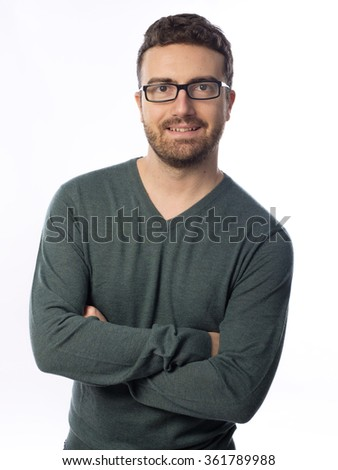 studio shot of young man wearing glasses against a white background