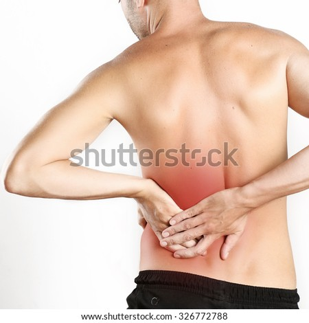 Studio shot of young man with pain in neck - stock photo