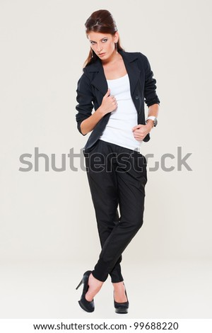 studio shot of young model over grey background - stock photo