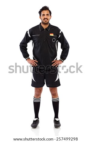 Studio shot of young soccer referee standing with his hands on hips over white background - stock photo