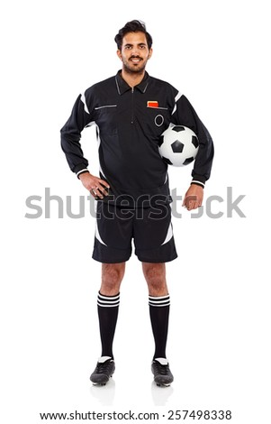 Studio shot of young soccer referee with a football standing on white background - stock photo