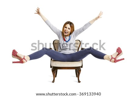 Studio shot of young woman enjoys with the whole body. - stock photo