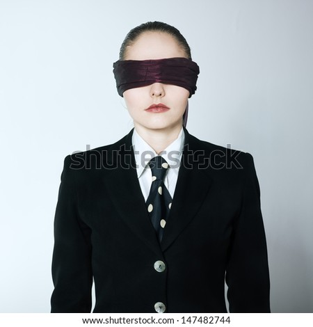 studio shot portrait of one caucasian young blindfold woman