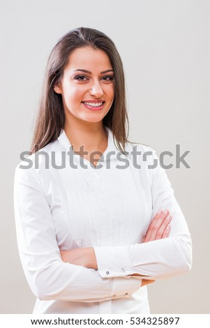 Studio shot portrait of young successful businesswoman.
