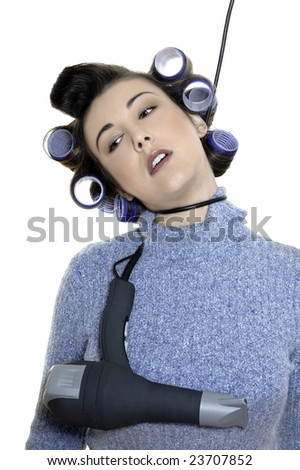 studio shot portraits of a young funny and cute woman on a white background being a hair-curlers victim