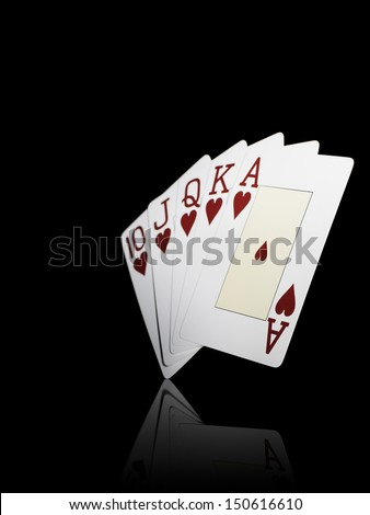 Studio shot showing poker cards with royal straight flush on black background.