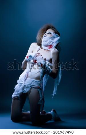 Studio snapshot of slim model posing as mummy - stock photo