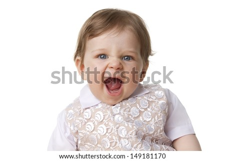 Studiophoto of a fashionably baby. Studiolight with isolated white background. Focus is on the face