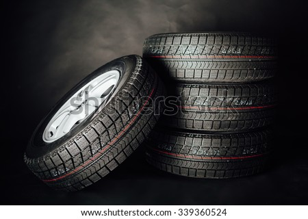 studless winter tires, black background - stock photo