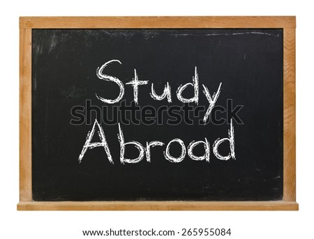Study abroad written in white chalk on a black chalkboard isolated on white - stock photo
