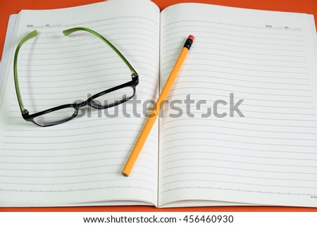 study book glasses pencil