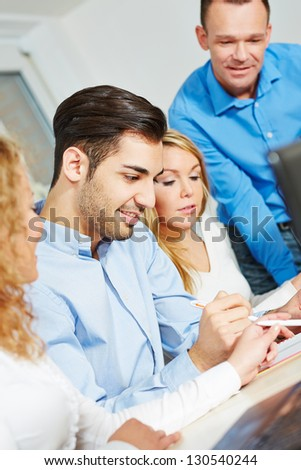 Study group learning in college with a teacher - stock photo