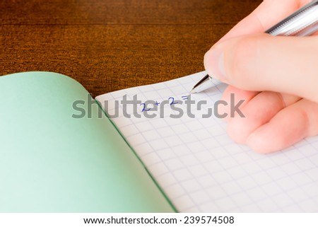 Studying in the school, solving mathematical problems - stock photo