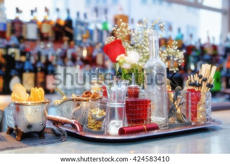 Stuff used for decorating cocktails on bar counter, toned, film grain added - stock photo