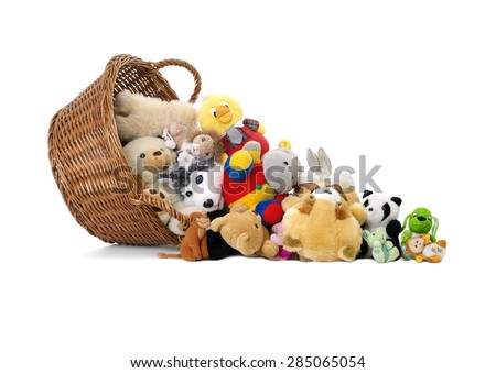 Stuffed animal toys in a basket, isolated on a white background  - stock photo