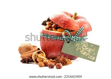 Stuffed apple with raisins and nuts isolated in white background - stock photo