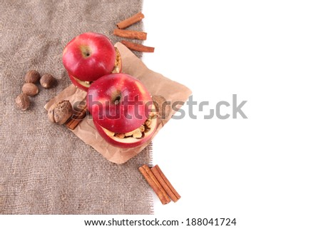 Stuffed apples with nuts and cinnamon on sackcloth isolated on white