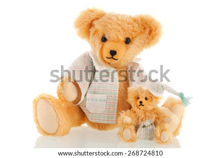 Stuffed bear in pajamas isolated over white background - stock photo