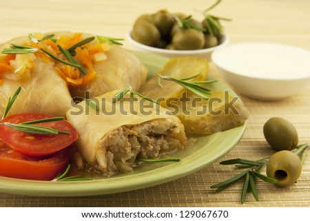 stuffed cabbage with olives   in ceramic plate