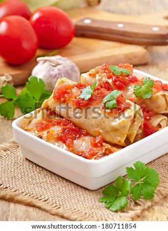 Stuffed cabbage with tomato sauce decorated with parsley - stock photo
