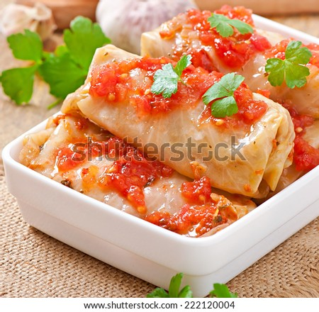 Stuffed cabbage with tomato sauce decorated with parsley