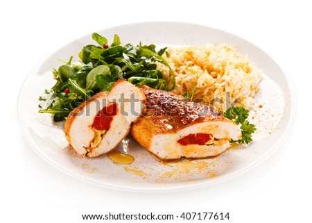 Stuffed chicken fillets and vegetables  - stock photo