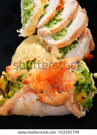 Stuffed chicken rolls with broccoli and vegetables. Shot from above.