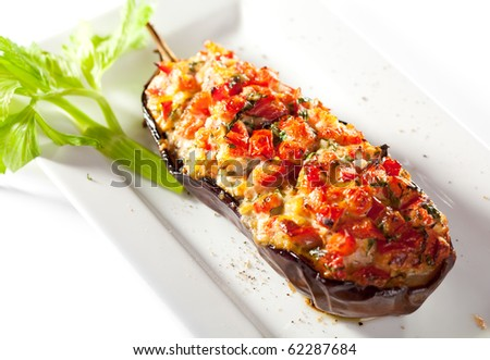 Stuffed Eggplant with Fried Vegetables. Garnished with Fresh Celery