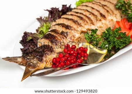 Stuffed fish on a platter - stock photo